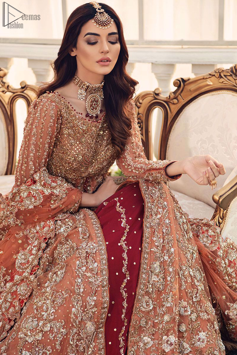 Pakistani Bridal Wear Salmon Front Open Gown - Maroon Back Train Lehenga - This fairytale ensemble is everything that you need to impress everyone. The front open dreamy gown is adorned with an embellished bodice, sleeves and embroidered daaman is giving a perfect ending to this flare. The maroon Lehenga is an example of remarkable handwork. The floor kissing asymmetrical lehenga add to its charm and falling to a dramatic train.