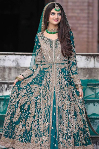This breathtaking fit and flare wedding dress offers comfort without compromising on style. Featuring beautiful handwork, this outfit has a delicate arrangement of hand-embellished floral patterns with champagne zardozi work along the length. Refined craftsmanship is at its best with a hand embellished belt clenched elegantly at the waistline. It comes with a sea-green lehenga adorned with tiny motifs spray all over the ground and exaggerated with embroidered lace bottom. This outfit is paired up with an organza dupatta with embroidered border to give it a perfect ending.