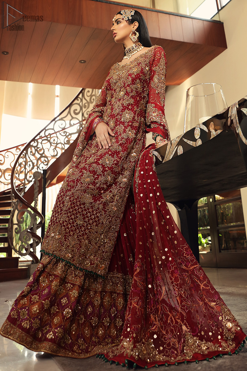Maroon bridal wear long shirt, appliqued Gharara and matching heavily embroidered dupatta. We will make you believe in fairy-tales! Ethereal handcrafted luxe ensemble, fit for a princess glammed out with gorgeous layers of hand-embroidered details, timeless silhouette and dreamy embellishment. The outfit is finished with beautiful maroon organza gharara having appliqued embroidery below the gott. This colourful gharara having thick embroidery borders gives it a regal look.