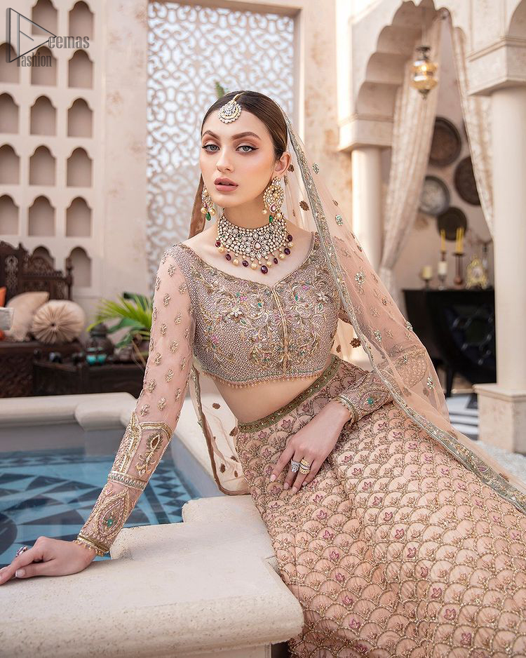 Pakistani Wedding Wear Peach Blouse Lehenga. DupattaThis breathtaking fit and flare wedding dress offers comfort without compromising on style. This nude peach colour is the perfect feminine and delicate shade with its meticulously crafted fabrication with gorgeous embroideries. The multiple colour embroidery The outfit comes with an embroidered belt. Adorned with sterling sequences and silver and crystal hand embellishments, it's a classic modern masterpiece!