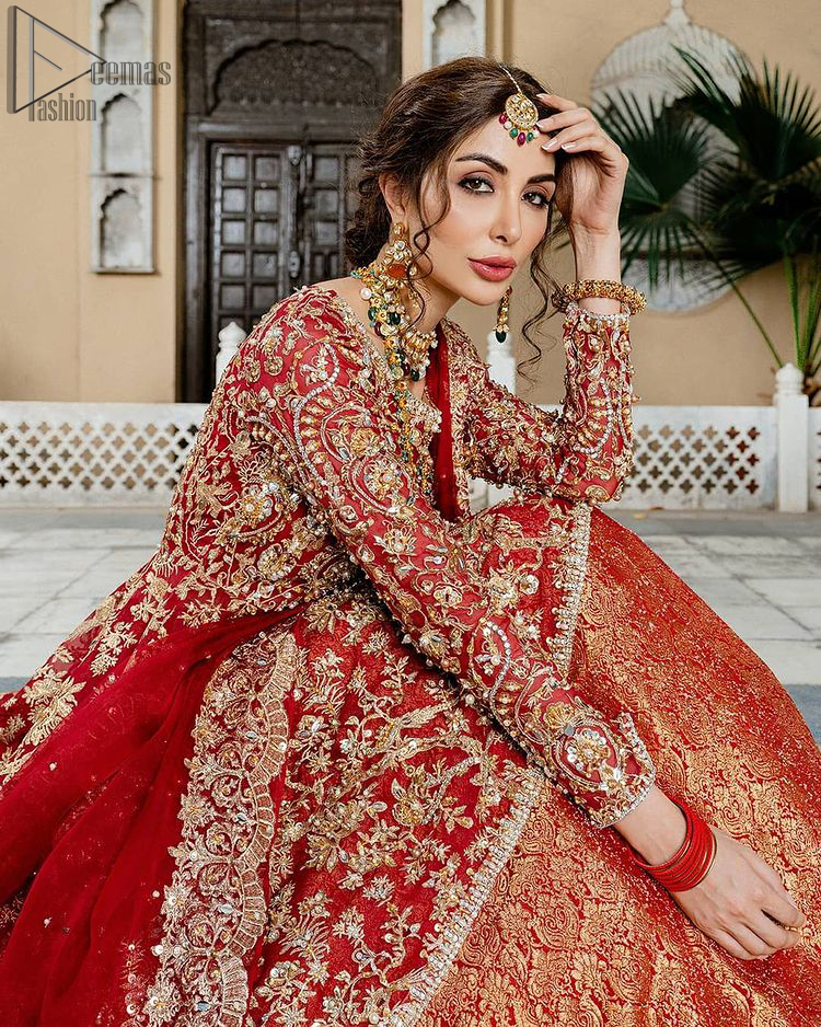 Red Bridal Peplum n Dupatta – Orange Lehenga. Red peplum with pure organza and fully engraved multi colour embroidery is such an eye-catching masterpiece that you would like to wear on your big day. Silver and golden combination of embellishment along with red pearls, Tilla Dabka, Appliques, Sequins and Zardozi work mainly gives such an eye feasting outfit to wear. The rounded, neckline and full sleeves give it a proper finishing in a beautiful attractive peplum style with Kattan Banarsi Jamawar exquisite Lehenga. With a concealed side zip closure along with floral motifs having finished edges. The Red organza dupatta has four-sided embellished borders.