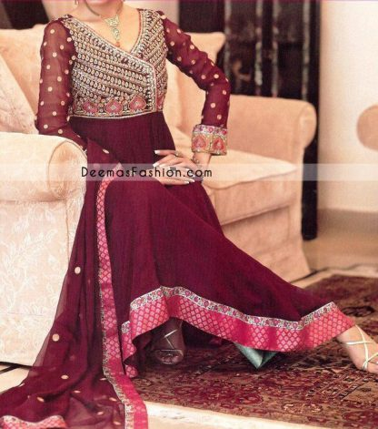 Deep red purple pishwas embellished on full bodice with zardozi hand embroidery. Bodice has heavy work on front using sequins, crystals, beads, thread etc, full sheer sleeves are embellished with small floral motifs spray all around. Paired up with churidar pajama and matching dupatta having banarsi patch all around the borders.