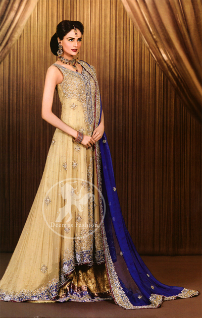 Light gold pure chiffon back trail frock. Frock has been adorned with long embellished neckline