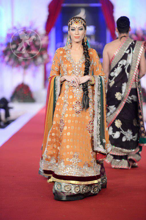 Mehndi-wear-dress-Organe-Yellow-A-line-Frock-and-bottle-green-lehnga
