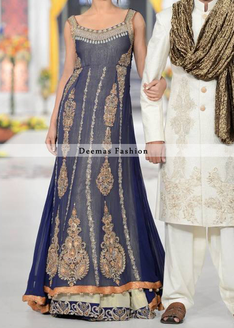 Navy blue pure chiffon sides down back trail frock with off white inner layer or lehenga. Frock has been adorned with embroidered neckline and motifs on both sides. Center panel has been embellished with large motifs and small borders. Embroidered lace implemented at the bottom of lehenga.