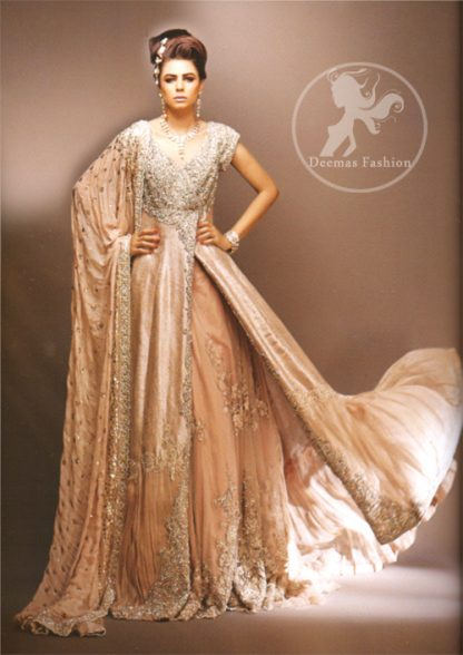 Pale peach side open double layer bridal wear maxi dress with heavy embroidered bodice and border on side slit. Large motifs implemented on inner layer.