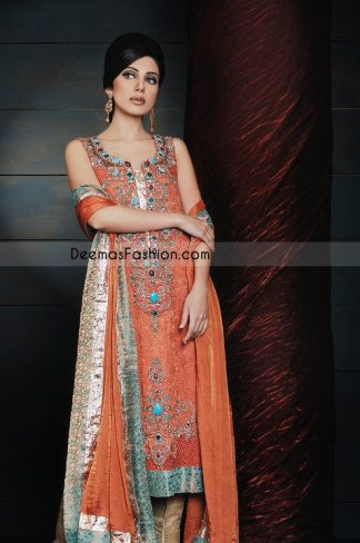 Rust self jamawar long shirt is fully embellished with beautiful embroidery on neck line. Embellishment works includes thread,tilla, beads and stone work. Double tone, sea green & rust self jamawar fabric is used on hemline border.