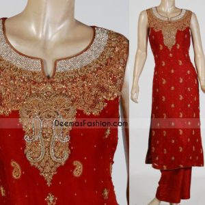 Red Katan silk shirt having floral embroidery on neckline. sequence and paisleys motifs all over. Piping edges finished.