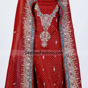 Red pure crinkle jamawar shirt featured appealing embellishment on neckline. Circular ornamental panels used in embroidery. Beautiful circular motifs implemented under embroidered V neckline.