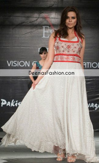 This floor length shirt is perfect for a day to evening wear. White embroidered fabric is used for pishwas which is adorned with embellished bodice finished with red piping. Bodice is decorated with red pearls and sequins all over. This sleeveless frock is paired up with churidar pajama and white self printed dupatta.