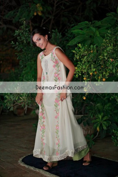 White pure crinkle chiffon Aline dress having embroidered motif under the neckline. Embroidered border has been implemented on hemline. Beautiful embroidery has been implemented on both panels. Fully lined dress. Concealed with back zip closure. This outfit is coordinated with parrot green bell bottom and white white dupatta with sequins spray all over it.